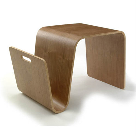 Single image of the Mag Table in walnut by the designer Eric Pfeiffer for the brand Offi. The shapely side table comes in the dimensions 40.6 x 64.8 x 35.6 cm, offers an extra compartment for magazins and is made of plywood and walnut veneer.