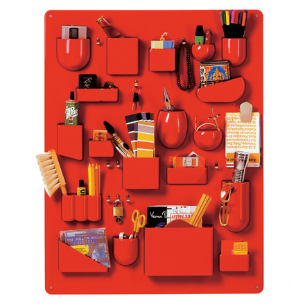 The red Uten.Silo I by Vitra filled with household accessories