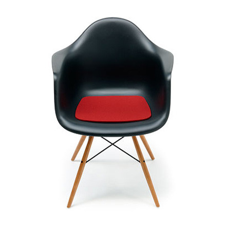 Frontal single image felt cushion in red by Hey Sign with the Eames Plastic Armchair in black.