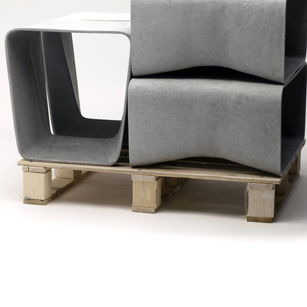 Eternit - Ecal stool in grey, stacked on a pallet