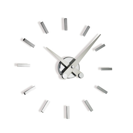 Puntos suspensivos wall clock by nomon with 12 hour marks made of chrome and steel