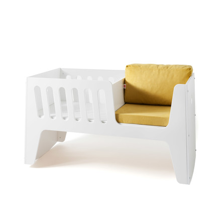 Rocky baby bed and cot by Jäll & Tofta  in white with cushion in mustard