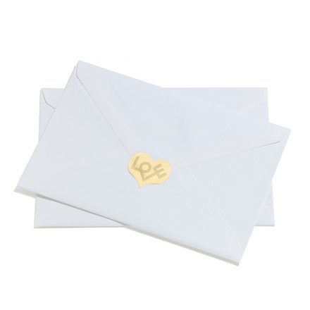 Sticker love heart by Vitra in gold on an envelope