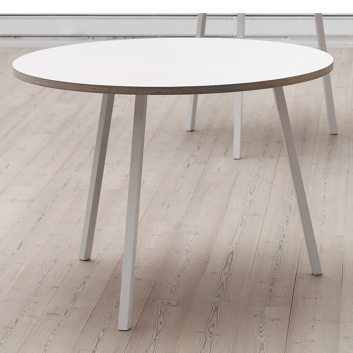The round loop stand table by hay in the shop for Table in table