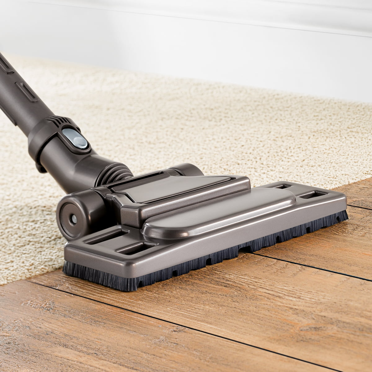 Dyson Hardwood Floor self adjusting cleaner head automatically adjusts for carpets and hard floors Dyson Musclehead Floor Nozzle In Use