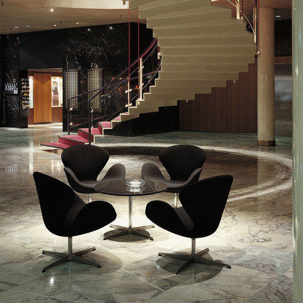 Swan armchair in a hotel lobby in marble