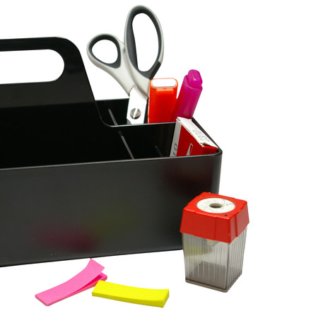 Close-up of the Vitra Storge Toolbox in basic dark with scissors, sharpener and highlighter. The design of the Storage Toolbox was coined by the designer Arik Levy. The idea behind the Toolbox is to store all working materials that are near you with only one grip.