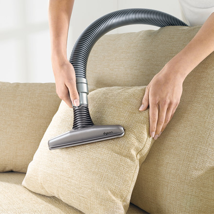 The Mattress nozzle by Dyson in use