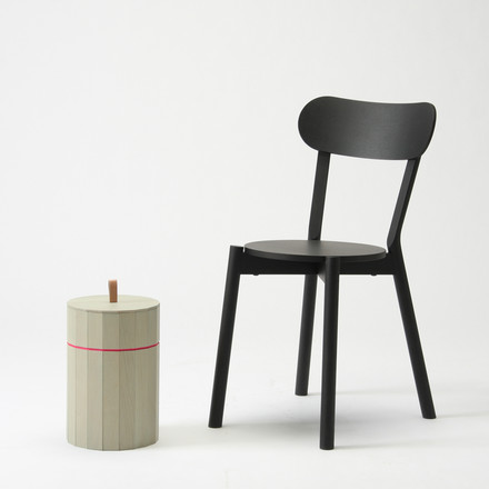 The Karimoku New Standard - Castor Chair in black with the Colour Bin