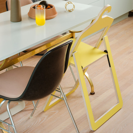 Umbra Hanger Chair, yellow at dining table