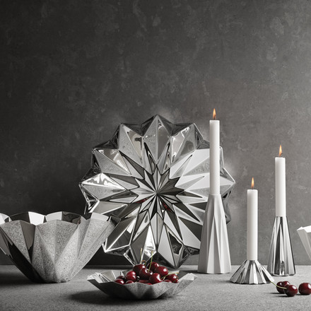 Georg Jensen - Supernova Bowl steel, with candles on the right