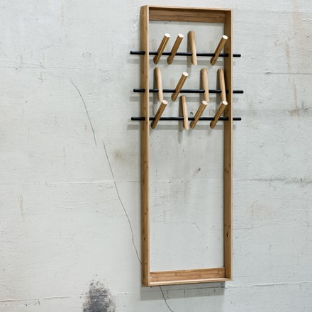 The coat frame by We Do Wood as a decoration object