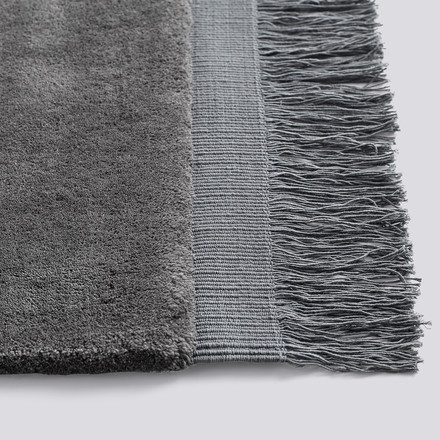 Fringed rug made of wool