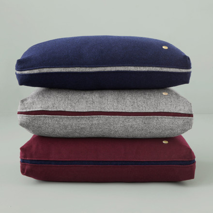 Woollen cushion available in various colours.