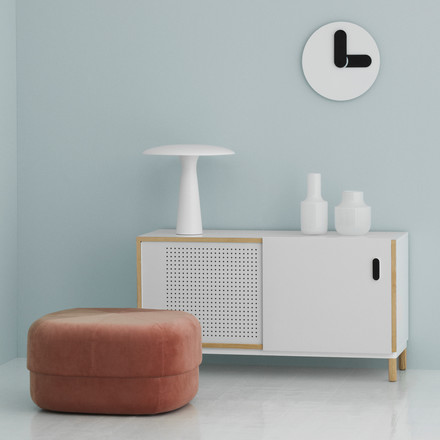 A contemporary interior in Scandinavian design: Classic silhouettes take on characteristic shapes and strong colours. Modern home accessories such as the Bold Wall Clock, Shelter table lamp and Circus pouf by Normann Copenhagen