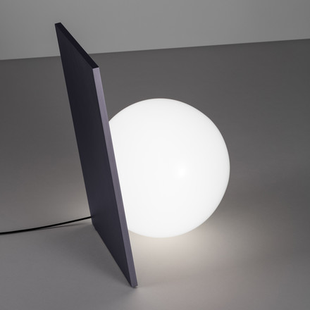 The Extra T Table Lamp in graphite anodised by Flos