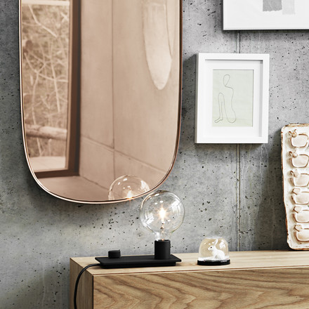 The Framed mirror and the Control table lamp by Muuto