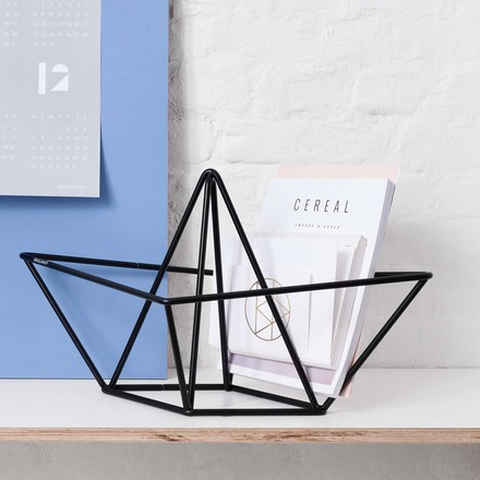 snug.Ahoy magazine rack by Snug.Studio