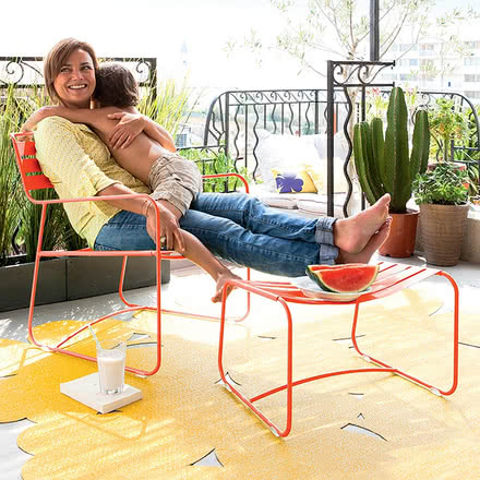 Surprising Lounger Armchair + Footstool by Fermob