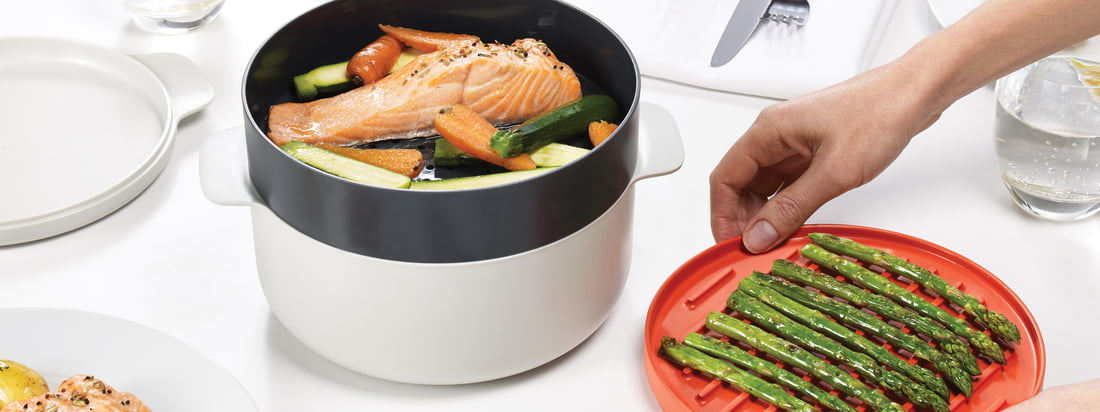 The M-Cuisine Collection by Joseph Joseph includes a pasta and rice cooker, an egg poacher, cool-touch bowl and plate, an omelette bowl and a 4-piece cooking set.