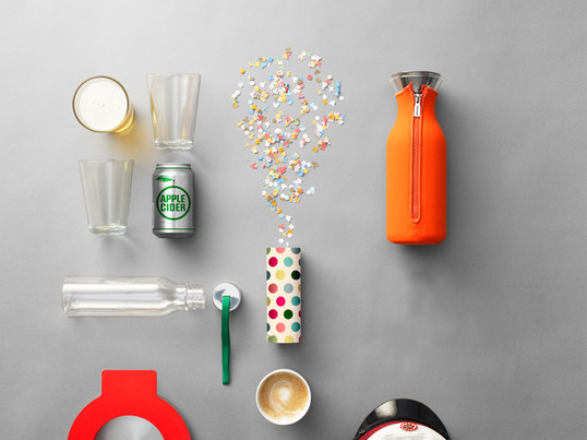 Eva Solo — the 1 L fridge carafe with orange neoprene coating, designed by Tools Design, the 0.5 L drinking bottle with a green strap and the drinking glasses are good containers for your drinks.