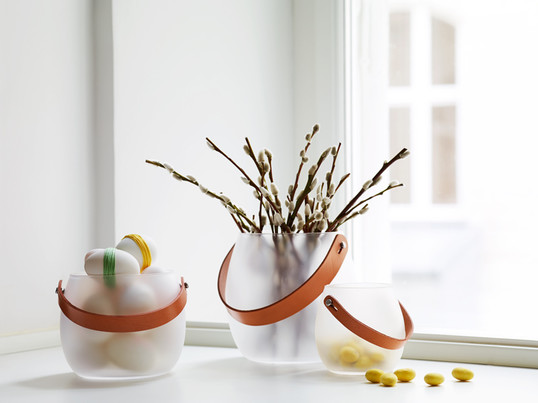 Maria Berntsen's Design With Light lanterns by Holmegaard radiate light and heat, both indoors and outdoors. Fruits, small treats and decoration are very well stored in them as well.