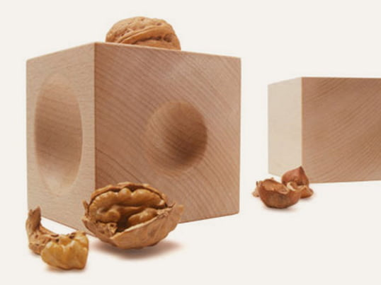 The Nusskubus Nut Cracker by siebensachen consists out of two waxed beech cubes. The cubes have three different anvil hollows, which can hold every nut size of the world.