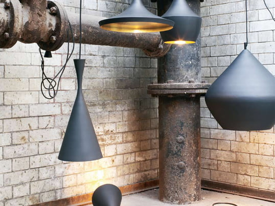 The Beat Light pendant lamps by Tom Dixon showcase elegant design from London. The shield is painted black and the inner brass color. They are available in three different forms.