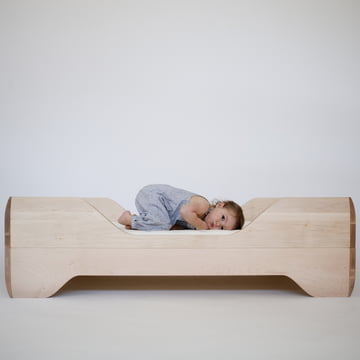 Low baby bed with wood frame
