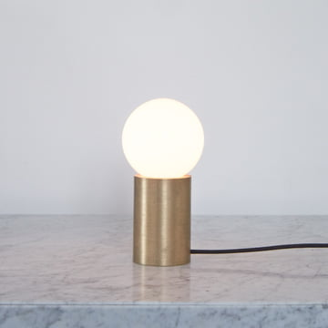Table lamp by Menu in a warm light